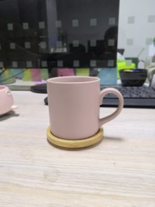 Ceramic mug with wooden saucer